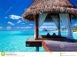 overwater spa and bungalows in tropical lagoon stock images