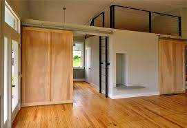 wondrous minimalist loft ideas with wide wooden single barn doors