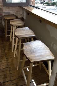 white kitchen counter stools stainless steel utensil hanging bar