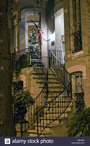 christmas decorations on a historic home in savannah ga stock