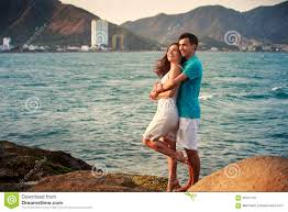 and guy hugging against azure sea stock photo image 56767797
