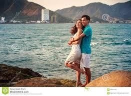 Free Hug Guy And Guy Hug On Stone Against Sea Stock Photo Image 56768639