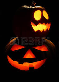 scary halloween pumpkin jack o lantern candle lit at church stock