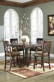 dining room tables set signature design by ashley leahlyn 5 piece cherry finish round
