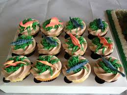 dinosaur cupcakes dinosaur cupcakes to match the cake were a hit with the kids