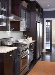 Wood Kitchen Cabinets With Wood Floors by Kitchen With Dark Cabinets And White Quartz Counters