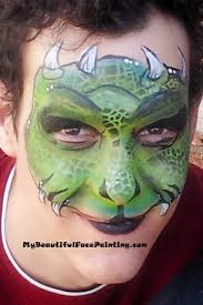 green monster face paint mask green yellow tag split scales