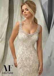 white wedding dress with gold beading elaborate allover embroidery and beading on a wedding dress