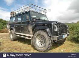 british land rover defender fishing rods on a british land rover 4x4 vehicle stock photo