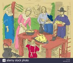 pilgrims celebrating thanksgiving dinner stock photo