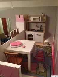 take an ikea kura bunk bed and make the top a play loft ally