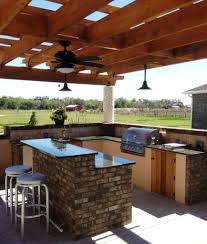 Outdoor Kitchen Lighting Ideas Attractive Brown Color Wooden Pergola Featuring Curved Shape