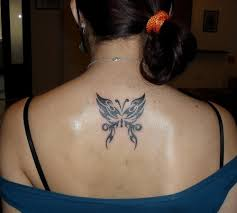 butterfly and lotus flower on back shoulder photos