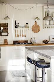 appliances hanging pot rack in an eclectic kitchen also wooden