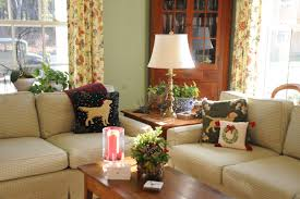 lauren huyett interiors your home should be as unique and i cozied up the couches with loads of christmas pillows celebrating our goldens judy also created a beautiful centerpiece in a sleigh that i had bought