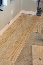diy wide plank floors made from plywood green notebook