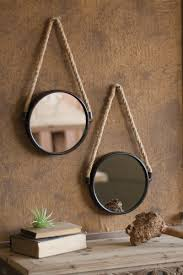 round mirror with heavy iron frame and hanger