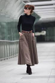 camel midi skirt with black turtleneck feminine ish fashion