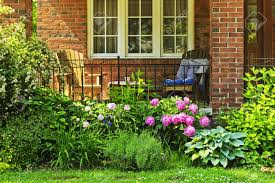 front of home with chairs and flower garden stock photo picture