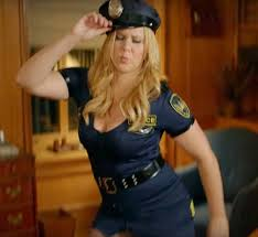 amy schumer shares bts snap of her cop costume from dog stripper