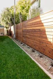Fence Ideas For Backyard by Building A Horizontal Plank Fence Horizontal Fence Pallets And