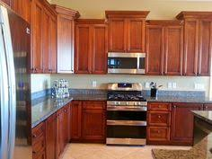 cambria bradshaw with cordovan maple cabinets kitchen