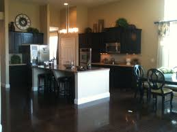 huge open concept kitchen with large island u0026 dark cabinets