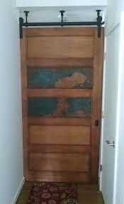 aged copper personalizes a barn door albee interior design