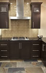 large khaki glass subway tile kitchen backsplash with dark brown