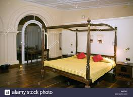 elegant bedroom with four poster bed in old harbour hotel heritage