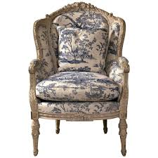 19th century antique french wingback bergere chair with toile
