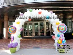 candyland theme balloon arch with lolipops party decorations
