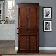 single door pantry cabinet with laminate flooring and grey color