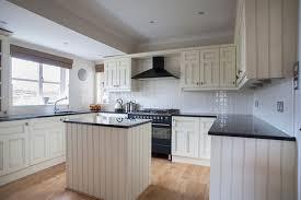 white kitchen cupboards black bench kitchen island bench designs ideas layouts better homes