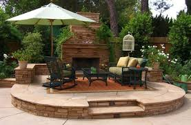 Stacked Stone Outdoor Fireplace - outdoor living cozy small patio design with stacked stone
