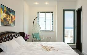white hanging chair for modern bedroom ideas with abstract wall