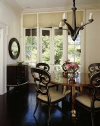 33 stylish dining rooms by truly fantastic interior designers the edges of these elegant dining chairs are rimmed in gold highlighting the carved backs