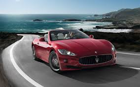 maserati road maserati grancabrio a convertible on a winding road along the sea