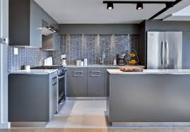 grey kitchen cabinets with white countertops built in ovens