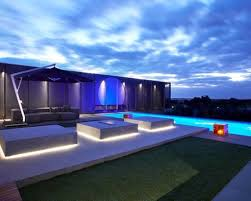 modern backyard ideas with long swimming pool using led outdoor