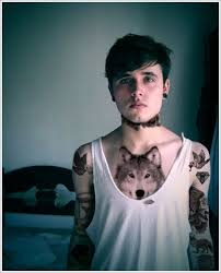 boy wolf on chest tattoomagz