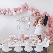pretty in pink second birthday balloon arch donuts pink and
