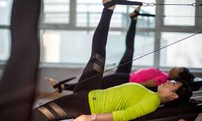 pilates trapeze table for sale how to choose the right pilates equipment for you overstock com