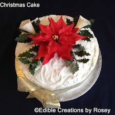 christmas cake with sugarpaste poinsettia calla lilies holly and