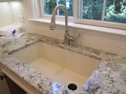 A Blanco SilGranit Kitchen Sink In The Truffle Finish Is Shown In - Blanco silgranit kitchen sink