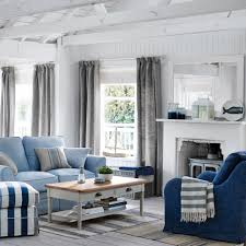 blue grey living room beach style with striped rug oriental area