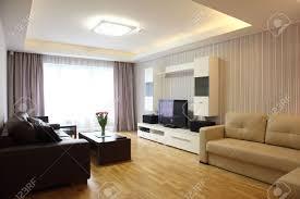 Modern Livingroom A Modern Livingroom Inside A New Flat With Modern Lighting Stock