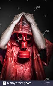 Halloween Costumes With Gas Mask by Radiation Nuclear Concept Man With Red Gas Mask Stock Photo