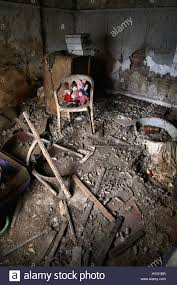 lichfield uk dolls lined up on a chair in the basement the