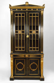 pair of english regency black lacquer and gilt bookcase cabinets